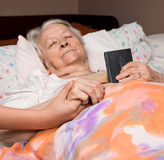 Caring girl holding old lady's hands Royalty Free Stock Photography