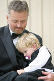 Caring Grandfather. Grandfather and grandson all dressed up Stock Image