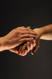 Caring Hands. Hands caring and supporting each other stock photo