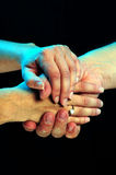 Caring Hands. Hands caring and supporting each other royalty free stock images