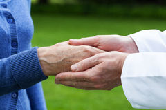 Caring hands. Doctor's hands showing care towards his patient Royalty Free Stock Image