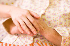 Caring hands - helping the needy Stock Photo