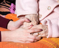 Caring hands holding old lady's hands Royalty Free Stock Photo