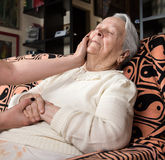 Caring hands holding old lady's hands. At home Royalty Free Stock Photo