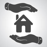 Caring hands icon - protecting house Stock Images