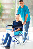 Caring husband handicapped wife Stock Photos