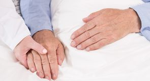 Caring about ill man Stock Images