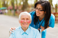 Caring Look over Patient. Caring nurse or doctor looking kindly on the elderly patient royalty free stock images