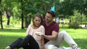 Caring man congratulating girlfriend on birthday or anniversary of relations. Stock footage stock video footage
