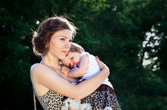 Caring mother with baby in nature Royalty Free Stock Photo