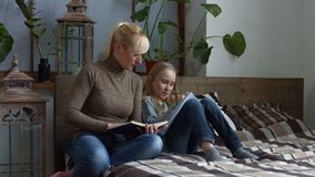 Caring mother helping her child with homework stock footage