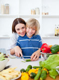 Caring mother and her son cooking. At home Royalty Free Stock Photos