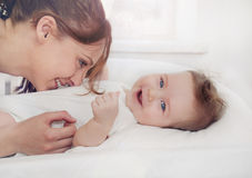 Caring mother laugh with her cute happy baby boy Stock Photography