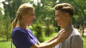 Caring mother looking at her teenage son with tenderness and love, adolescence. Stock footage stock video