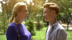 Caring mother looking at her teenage son with tenderness and love, adolescence. Stock photo stock photo