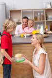 Caring mother packing the school lunch to his son Stock Images