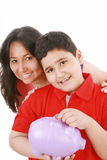 Caring mother teaching her son to save Royalty Free Stock Images