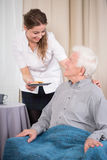 Caring nurse and older man Royalty Free Stock Photos