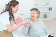 Caring nurse supporting patient Stock Photos