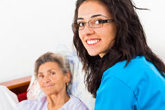 Caring Nurses. Nurses caring for elderly patients suffeing from disease in nursing home royalty free stock photo