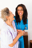 Caring Nurses. Nurses caring for elderly patients suffeing from disease in nursing home stock photography