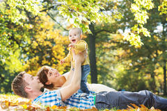 Caring parents looking after baby Royalty Free Stock Image