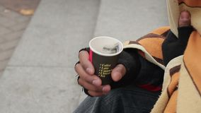 Caring people giving money to homeless beggar man, poverty, depression, charity. Stock footage stock video