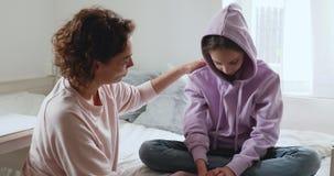 Caring single mother helping sensitive depressed teenage daughter after divorce