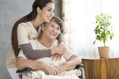 Smiling woman hugging grandmother Royalty Free Stock Photography