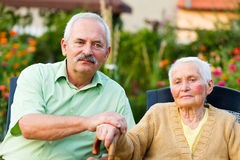 Caring Son. Mature son comforting her mother who is resident of a nursing home Royalty Free Stock Photos