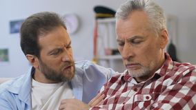 Caring son supporting his military retired father, posttraumatic stress disorder. Stock footage stock footage