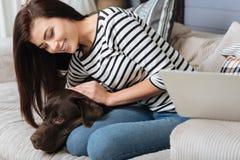 Caring sweet woman hugging her pet Royalty Free Stock Photo