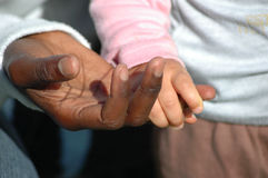 Caring touch stock photography