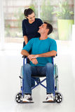 Caring wife husband. Caring wife talking to disabled husband at home Royalty Free Stock Photography
