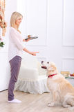 Caring woman feeding the dog Royalty Free Stock Photos