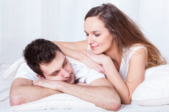 Caring woman and sleeping man Royalty Free Stock Photography