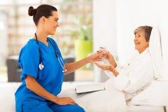 Caring young caregiver stock photos