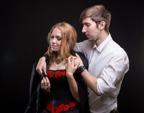 Caring young man and his beloved woman. Caring young men and his beloved women on black background Stock Photography