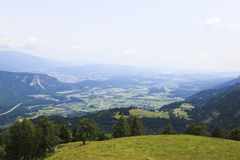 Carinthian Drava valley from Pec Mountain, Austria. The borders of three countries, Slovenia, Austria and Italy meet on top of Pec Mountain. The three border Royalty Free Stock Images