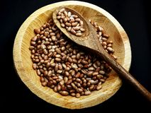 Carioca Beans into a bowl. Agriculture, seed. Phaseolus vulgaris is scientific name of Pinto Bean legume. Also known as Frijol Pinto and Feijao Carioca. black stock photo