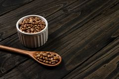 Carioca beans in pot. Wooden black background.  royalty free stock photo