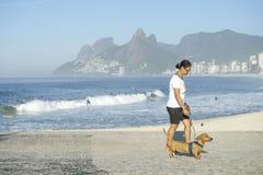 Carioca Brazilian Woman Walking Dog in Rio Royalty Free Stock Photos