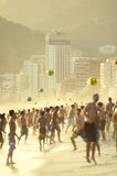 Carioca Brazilians Playing Altinho Beach Football. Groups of carioca Brazilians gather on the shore of Ipanema Beach to play beach football at Posto Nove royalty free stock images