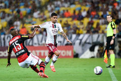 Carioca champioship. RIO DE JANEIRO, RJ/Brazil - april 05, 2015: Players Jean and Luiz Ant�nio in ball dispute during starting Flamengo vs Fluminense royalty free stock images