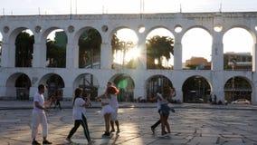 Carioca swing dancers 20-25 practice near 19th-century colonial Lapa Arches, Rio de Janeiro, Brazil -