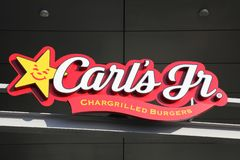 Carl`s jr logo on a wall. Tilst, Denmark - October 14, 2018: Carl`s jr logo on a wall. Carl`s jr is an American fast food restaurant chain operated by CKE stock photography