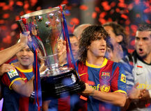 Carles Puyol holds La Liga Trophy. Carles Puyol of FC Barcelona holds the La Liga trophy after the match between Barcelona and Deportivo La Coruna at Camp Nou royalty free stock photography