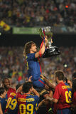 Carles Puyol holds up La Liga Trophy. BARCELONA, SPAIN: Carles Puyol of Barcelona holds up the spanish league trophy after the La Liga match between FC Barcelona royalty free stock images