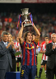 Carles Puyol holds up spanish Super cup. BARCELONA, SPAIN : Barcelona's Carles Puyol holds up the spanish Super cup after the second leg football match between Stock Image