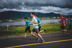 Group of 10K Runners in front of a beautiful Mountain Landscape
